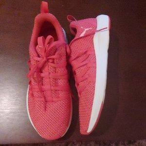 Pink and white puma tennis shoes